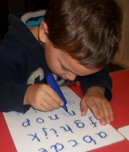 Boy doing abc cropped